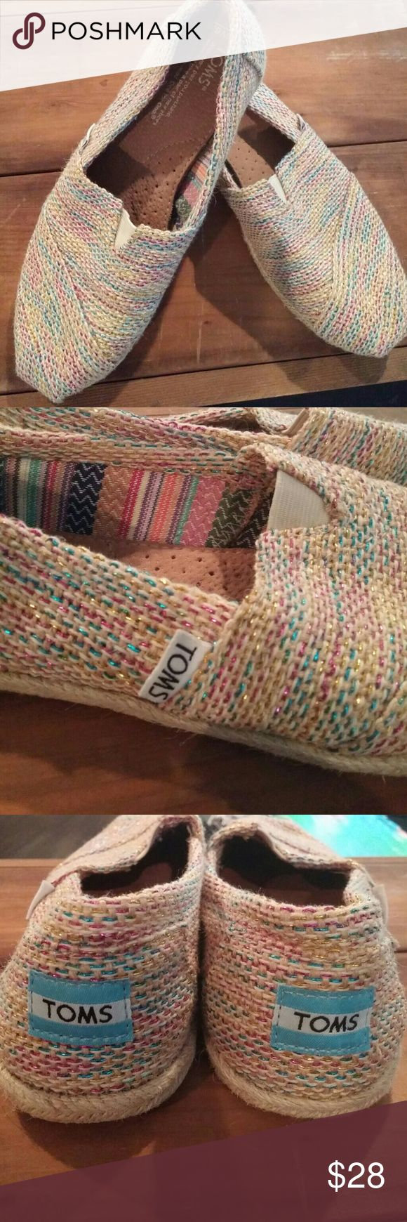 Toms classic slip on shoes Really cute Toms slip on shoes. Tan with Multi color stitches. Like new with the little wrar on the bottom. Insole perfectly clean. Toms Shoes Flats & Loafers