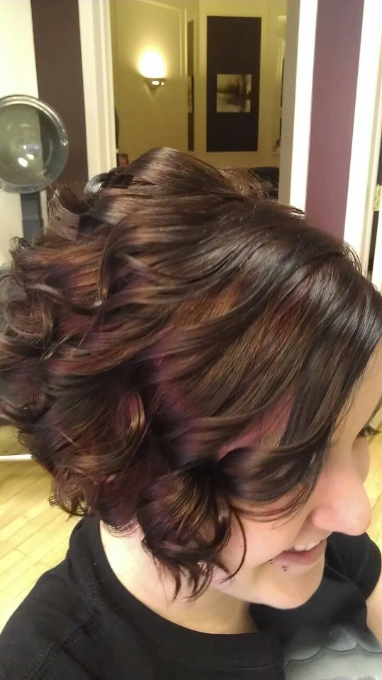 Black and red peekaboo highlights from New Style Salon