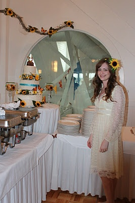 #Bride in front of #homemade #wedding #cake with #sunflowers in a #vintage wedding #dress