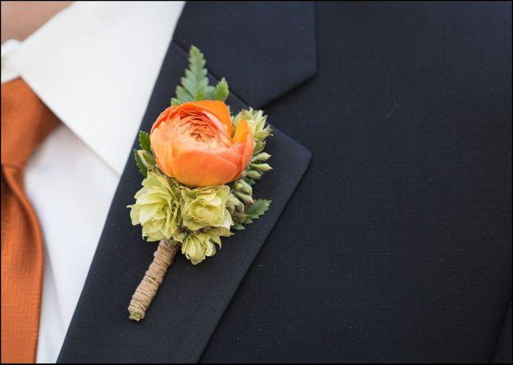Orange ranunculus and hops boutonniere wrapped in twine. #floraldesign #orangeflowers #hops www.floraldesign.me crystalmadsenphotography.com