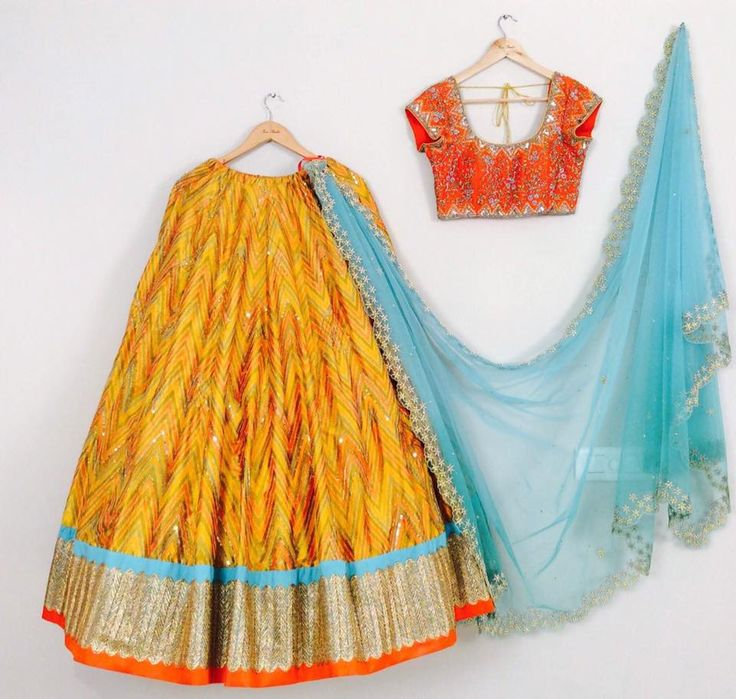 SC-L1200: mustard yellow Ikath lehenga and orange blouse with hand embroidered dupatta!!!!Issa Studio can customize the colour   size as per your requirement.To order please call/ WhatsApp on 9949944178 or mail @issadesignerstudio@gmail.com  02 April 2017