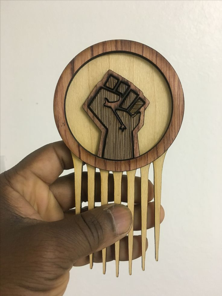 Afrofuturistic Styling Combs and Afro picks hand made from exotic hardwoods for Natural, Curly and Kinky Hair!  www.carbon-ar.com