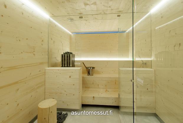 Lammi-Kivitalo Majan selkälinjainen sauna ja kylpyhuone.