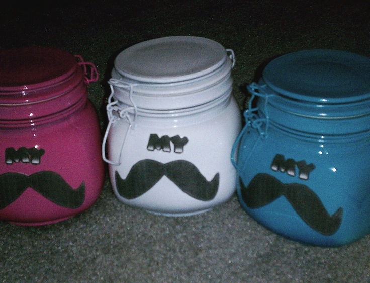 """""""Piggy banks"""" for the kids in my family.  Bought jars at Dolalr Tree that latch ($1 each) - spray painted 2 coats of different colors that I had in my garage, let dry overnight, printed off mustache pictures from online, cut them out and hot glued them on the jars! Super cute!!"""