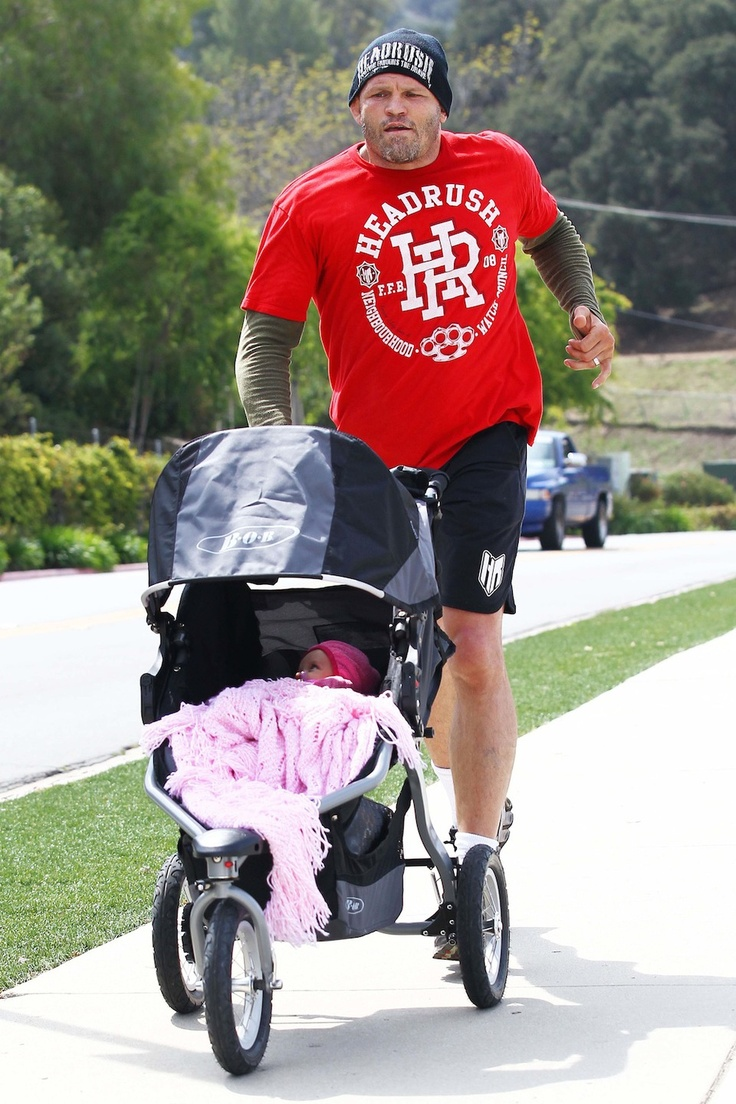 Chuck Liddell & Guinevere: Morning Jog Here's my favorite UFC fighter jogging with his little girl. This world is awesome.