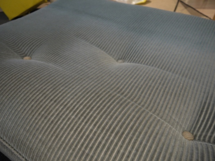 Old light blue fabric is corduroy-type