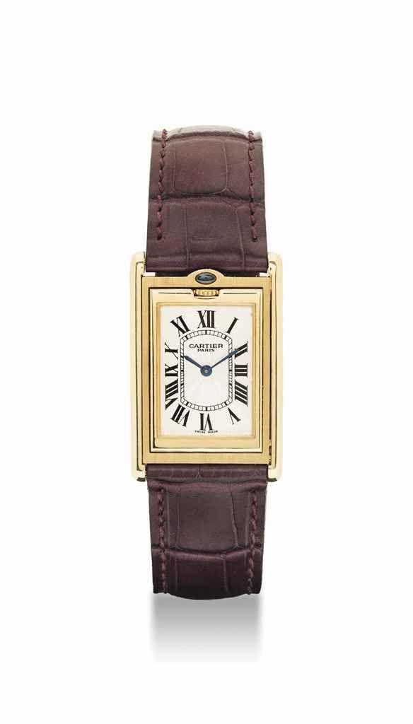 Cartier. A fine and unusual 18K gold and sapphire-set rectangular reversible wristwatch. circa 1997. #watch #ChristiesWatches