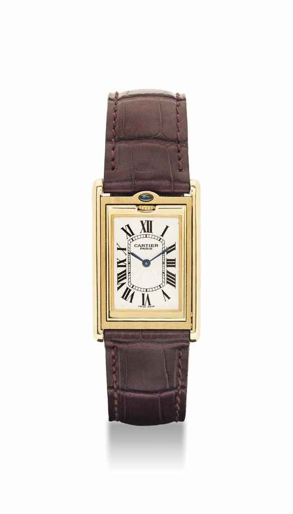 Cartier. A fine and unusual 18K gold and sapphire-set rectangular reversible wristwatch. circa 1997. #watch #ChristiesWatches