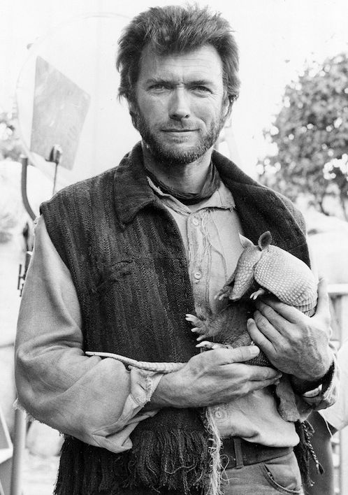 Clint Eastwood holding a armadillo | Rare and beautiful celebrity photos