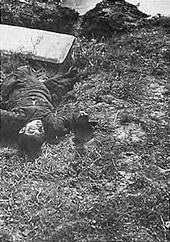 Nanking Massacre - A boy killed by a Japanese soldier with the butt of a rifle because he did not take off his hat.