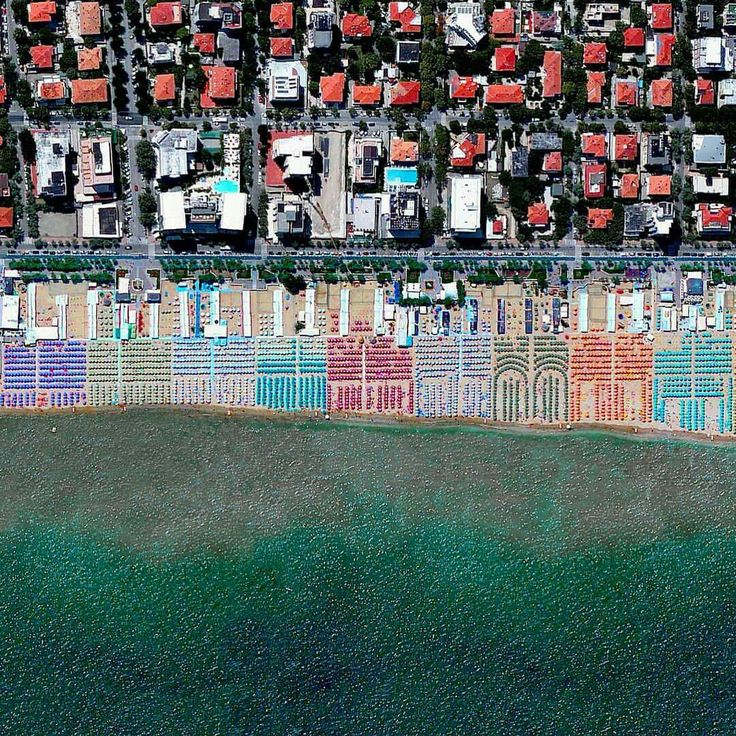 Umbrellas dot the beaches of Pesaro, Italy. The town is located on the Adriatic Sea and maintains an average temperature of 27° C (80.6° F) during the summer months. /// Created by @benjaminrgrant, source imagery: @digitalglobe
