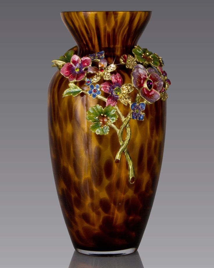 Handcrafted vase. Mouth-blown glass with cast-metal collar. Hand enameled and…