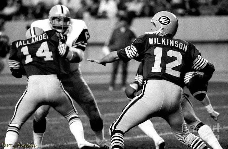 Edmonton Eskimos QB Tom Wilkinson #12 attempts a pass in a game against the Hamilton Ti-Cats in 1981.