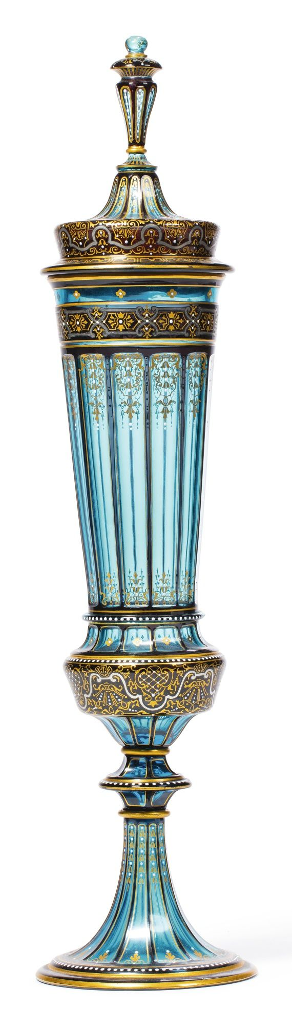 A J. & L. LOBMEYR JEWELLED TURQUOISE GLASS LARGE CUP AND COVER CIRCA 1880 of elongated faceted form, painted and gilt with stylized foliate- and strapwork, white enamel JLL monogram mark. height overall 21 in