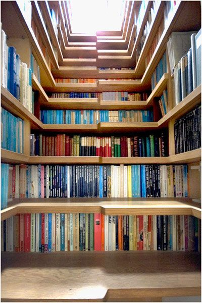 Bookshelves built into the stairs...a very clever use of space!