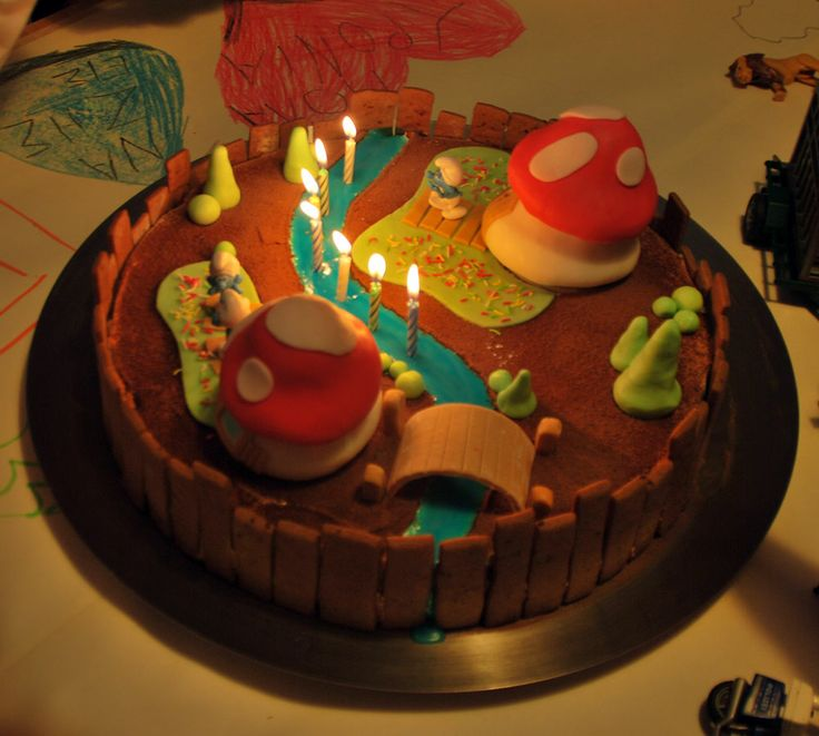 smurf birthday cake decorated with handmade biscuits and fondant