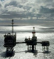 A north sea oil rig with a dramtic sky background