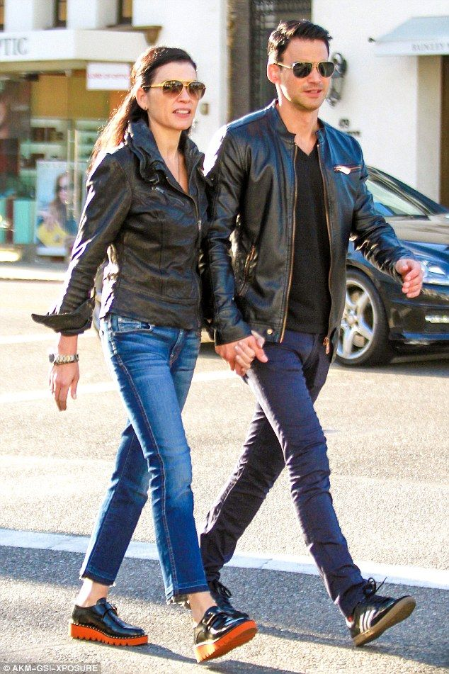 In sync: On Friday Julianna Margulies and her husband Keith Liberthal went on a shopping date in Beverly Hills, rocking strikingly similar looks that included Ray-Ban aviators and black leather jackets