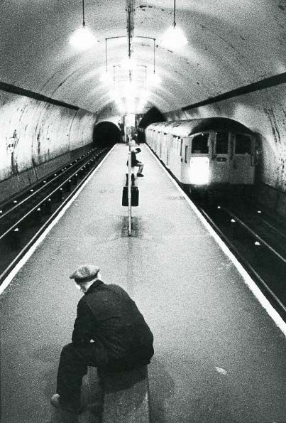 Angel Underground Station, 1968 Islington, London. The dangerously narrow island platform has since been modified into two separate single platforms, one for each direction .