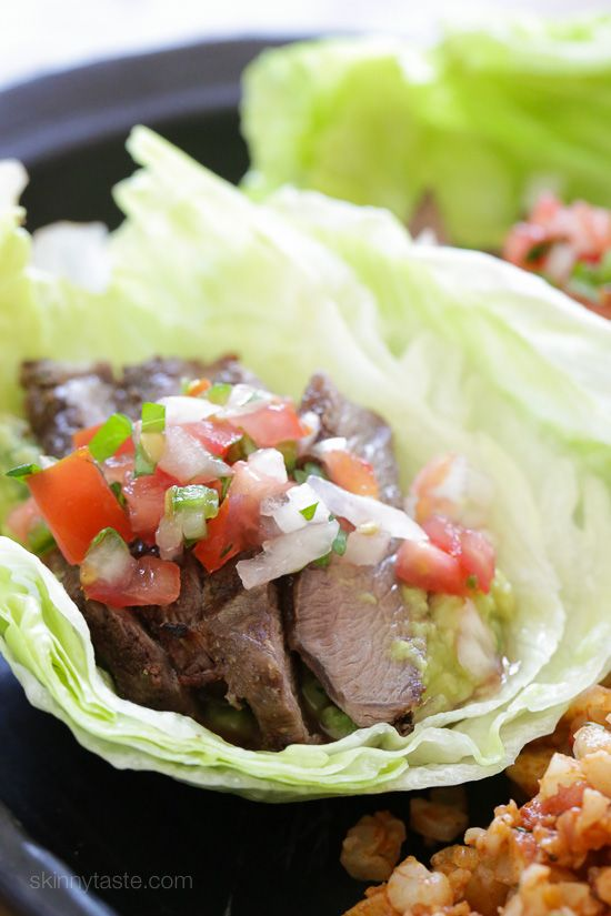 """Grilled sirloin steak """"flaco"""" tacos uses lettuce instead of tortillas! The steak is seasoned with cumin and spices, then grilled and sliced thin, along with guacamole and pico de gallo – low-carb and super delicious!"""