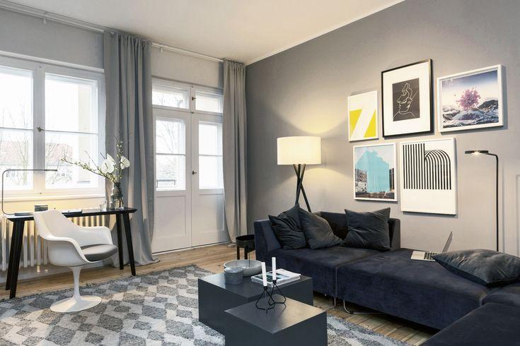 Wohnzimmer mit großzügigem Modul-Sofa (Orlando von Bolia) und Bilderwand mit kleiner Petersburger Hängung in einem Zwanzigerjahre-Apartment in Berlin-Zehlendorf.