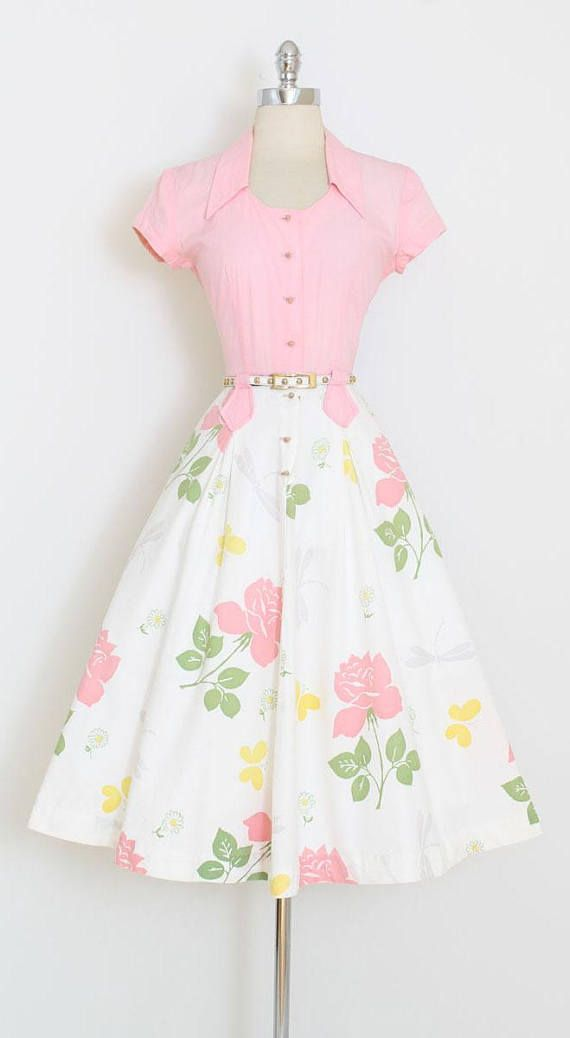 ➳ vintage 1940s dress  * fabulous design by Doris Dodson * novelty print on cotton * butterflies, dragonflies, roses * button front bodice * a-line skirt * belt shown is not included  condition | excellent  fits like xs/s  length 45 bodice length 17 bust 36-38 waist 26-27 hips 44  ➳ shop http://www.etsy.com/shop/millstreetvintage?ref=si_shop  ➳ shop policies http://www.etsy.com/shop/millstreetvintage/policy  twitter | MillStVintage facebo...