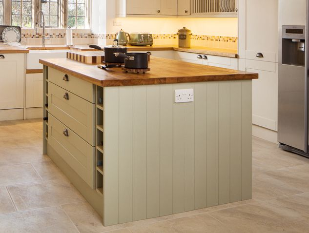 This kitchen island unit is painted in Farrow & Ball's Mizzle – a beautiful feature for solid wood kitchens