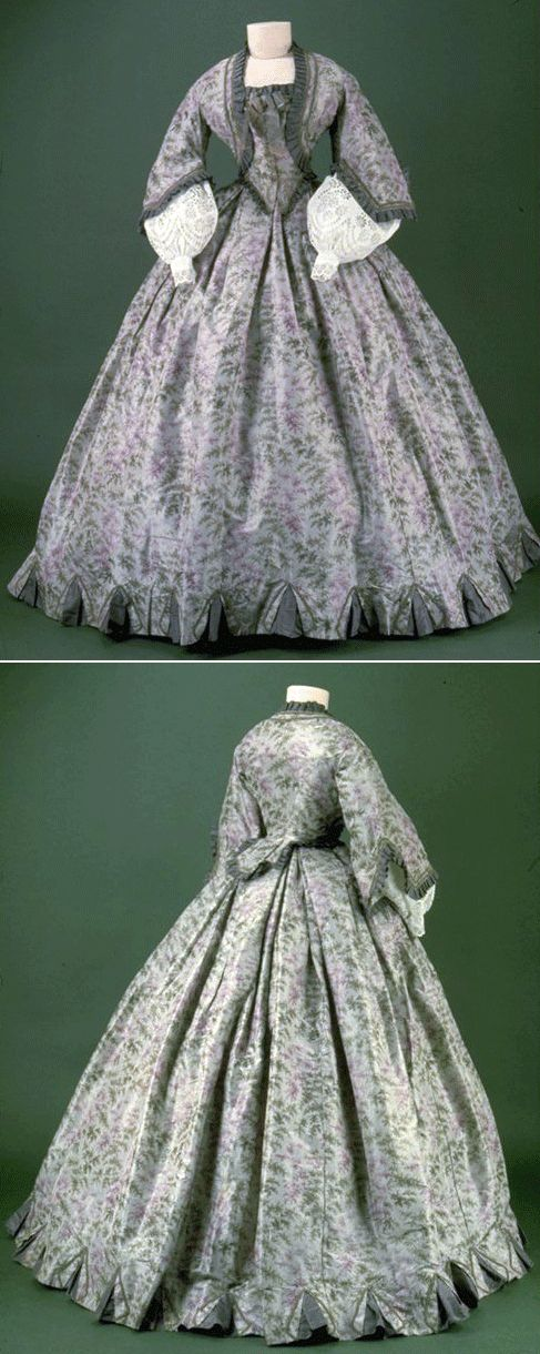 1860s, gray silk branches of patterns and flowers, trim gives illusion of bolero and vest. Skirt circumference 4,63m, London Museum.  costume.over-blog.com