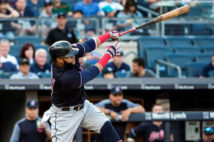 DOUBLE TRUBLE:    The Indians first baseman Carlos Santana (41) hits an rbi double during the first inning against the Yankees in New York, NY. The Indians won 9-4.