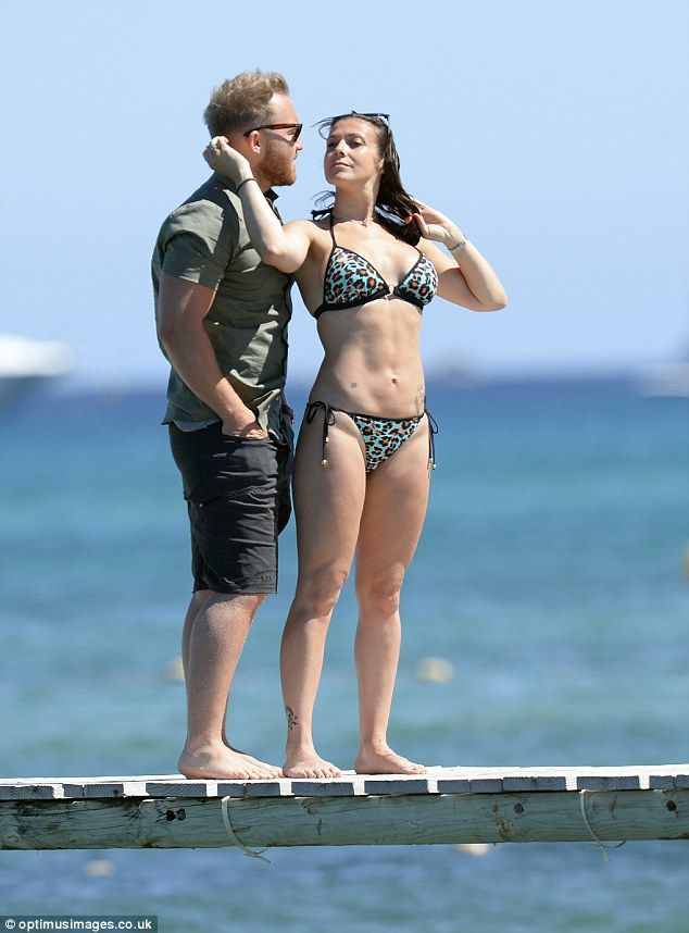 Bikini babe: Kym Marsh, 40 and her personal trainer toyboy Matt Baker appeared to be more in love than ever when they were pictured holidaying in St Tropez in the South Of France