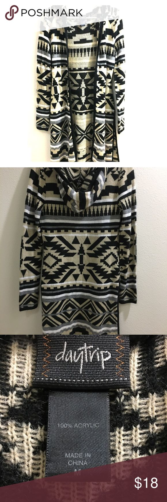 Daytrip cardigan/sweater long sleeve Aztec top Fuzzy material, has hood, about knee length (I'm 5'3), size medium sweater. Bottom has slits on both left and right sides. Very soft/warm material. Only worn a couple of times, no damage. Daytrip Sweaters Cardigans