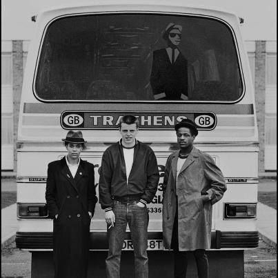 Pauline Black of The Selecter, Suggs of Madness and Neville Staples of The Specials pose behind the tour bus at the first date of the 2 Tone Tour in Brighton, United Kingdom in October 1979. The 2 Tone Records 'Walt Jabsco' logo is visible in the bus window. (Photo by Chalkie Davies/Getty Images)