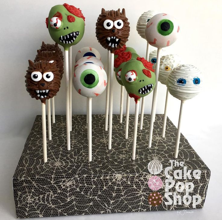 Halloween cake pops in full swing! Don't they look nice and creepy in my decorated @brpboxshop cake pop box?! #halloweencakepops #keepingitsimple #eyecakepops #werewolf #werewolfcakepops #mummycakepops #zombiecakepops #halloween #cakepop #cakepops #mycupcakeaddiction #jacksonvillehalloween #jacksonville #jacksonvillecakepops #brpboxshop