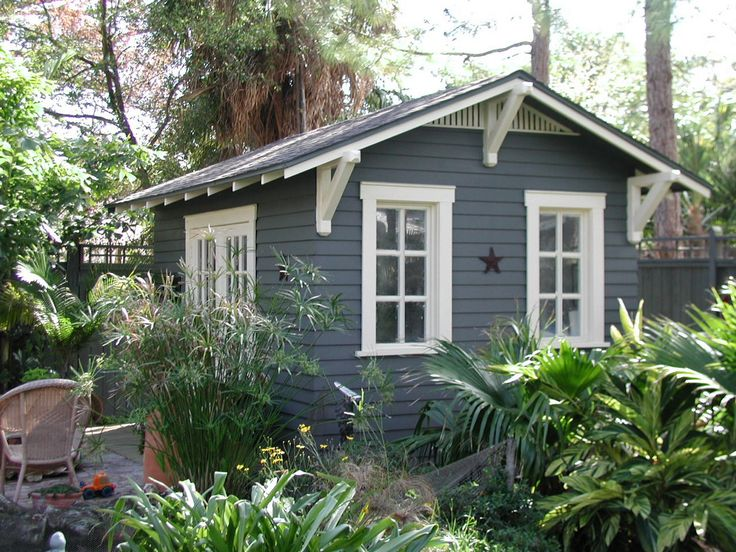 Custom 10'x14' home office shed designed to complement a 1923 bungalow in Florida by Historic Shed. The interior was finished with bead board ceiling, board and batten walls and wood floor. The shed was wired for cable and internet.