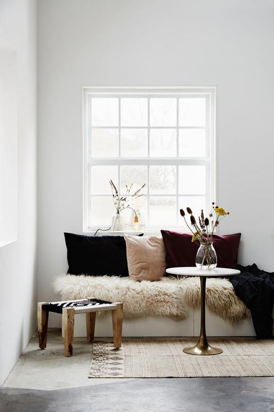 interior styling bench seating living room fur cushions alcove