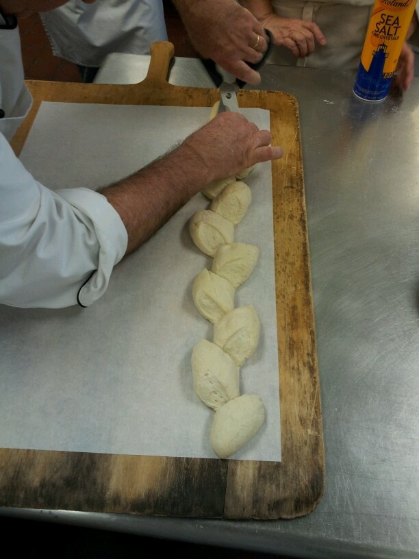 Cut a baguette at a 45 degree angle 3/4 of the way through and twist each piece alternating left and right.