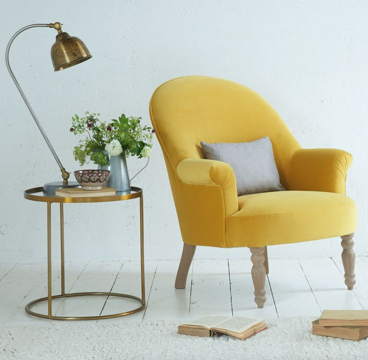 From magazine-flipping to tea-sipping, the comfy Munchkin chair is all about down-time. This classic occasional armchair is handmade in Britain and comes with solid weathered oak legs. Upholstered here in Bumblebee yellow velvet.