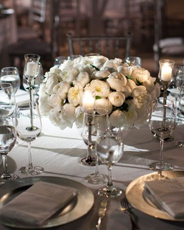 Peonies placed in simple silver bowls for an understated and elegant centerpiece