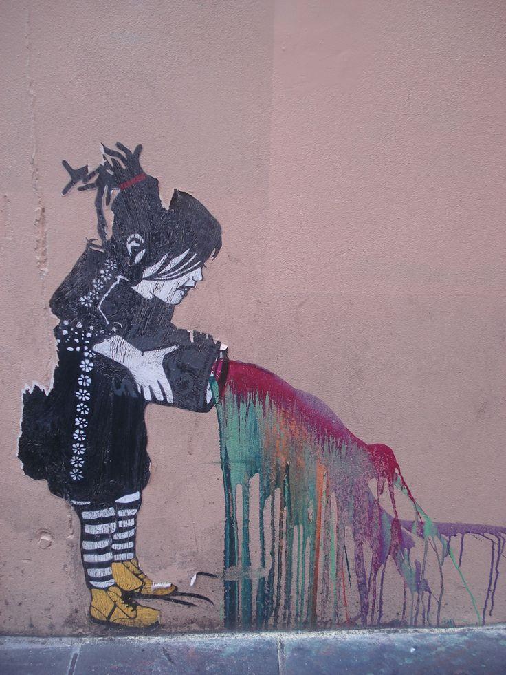 Melbourne street art  000 Girl emptying paint.