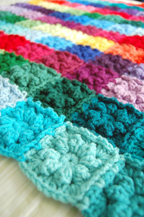 There are 120 little flowers in this one-of-a-kind, cheery, hand crocheted blanket. Each square is about 3. I used over 33 different colors. All
