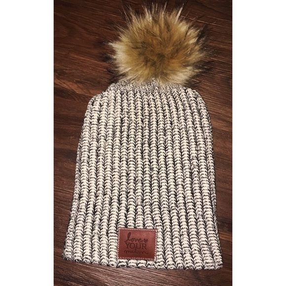 Love Your Melon Black and White Pom Pom Beanie NWT Love Your Melon Beanie... I'm looking to get what I paid for it back including shipping... They sent me the wrong one and would not take it back. Love Your Melon Accessories Hats