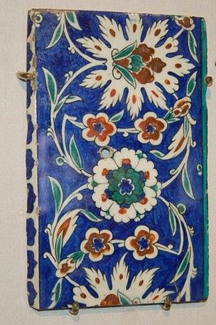 Tile. Made of polychrome painted and bevelled and glazed pottery.