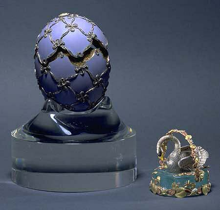 """The 'Swan' Faberge Egg, made in 1906, a gift from Czar Nicholas II to his mother, the Dowager Empress Maria Fyodorovna. The surprise inside the egg was a miniature gold & silver swan on a """"lake"""" of aquamarine. By winding the gear under one of the wings, the swans neck and wings move. In Russia, the swan is considered a symbol of family life & represents the permanence of the bond of marriage."""