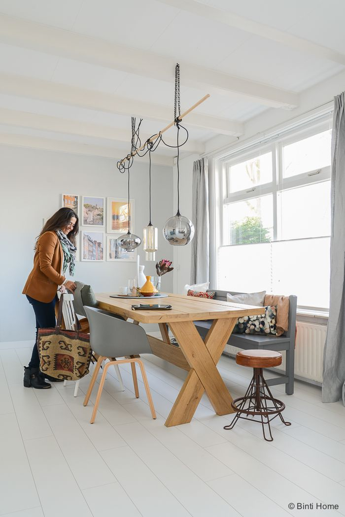 Interior oak table, house doctor lamps, grey wall with photoframes, styling diningroom ©BintiHome