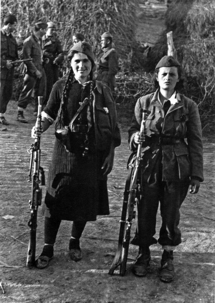 Serbian Partisans of the 1st Proletarian Brigade, National Liberation Army and Partisan Detachments of Yugoslavia pose for a photograph with their ZB vz. 26 light machine guns during the Belgrade Offensive.