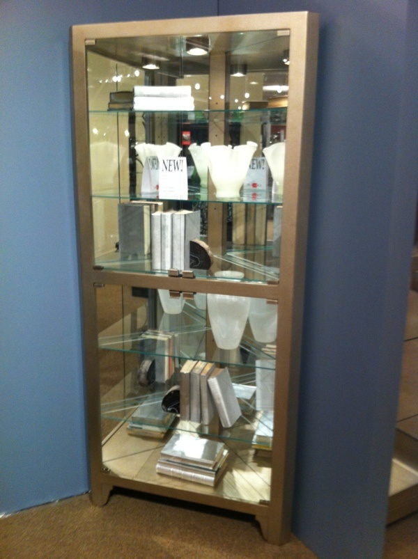 This modern inspired corner curio cabinet at Pulaski (Home Meridian) is  fabulous. #