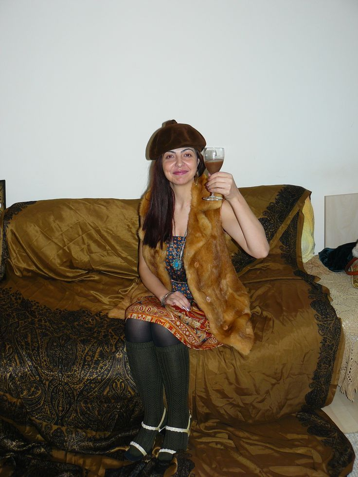 Vintage 70s skirt (worn as a dress), vintage 60s hat, orange fur vest, turquoise pendant, sandals worn with lacey socks