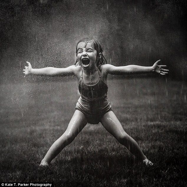 Wild woman: This little girl let out a delightful scream as she ran through sprinklers in her bathingsuit