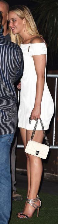 Who made Jennifer Lawrence white off the shoulder dress, handbag, and sandals?