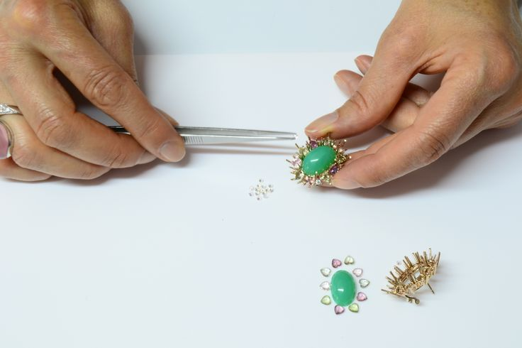 Emanuela Burgener selecting best  sapphires to set the crysoprase earclips.